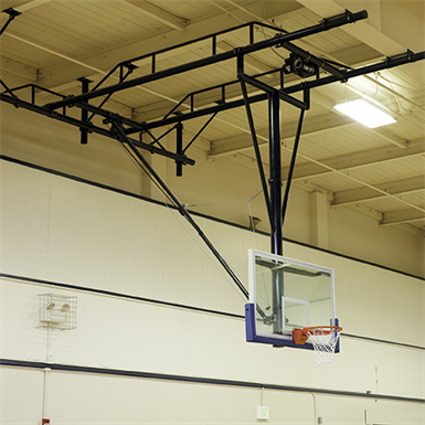 Tb 25 ceiling suspended rear folding basketball backstop for Basketball gym dimensions